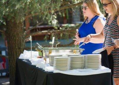 Guests at Zoobilation enjoying delicious catering by Baratta's.