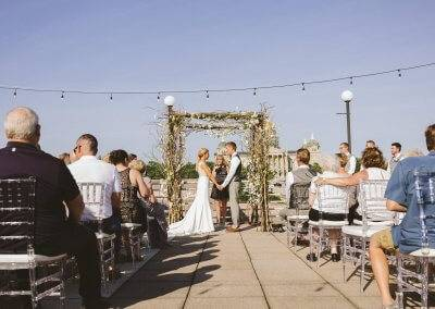 Stunning wedding ceremony on the rooftop terrace at the State Historical Building (photography by Kara Vorwald)