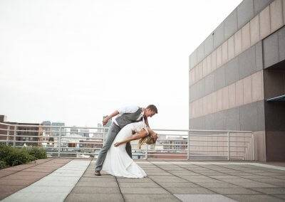 The newlyweds dip on the terrace (photography by Kara Vorwald)