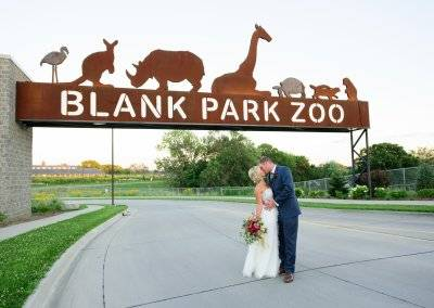 The newly married couple at the Blank Park Zoo entrance