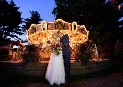 A sweet moment in front of the carousel