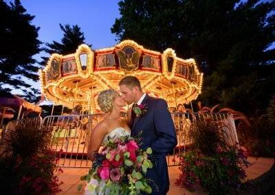 Newlyweds in front of the Blank Park Zoo carousel