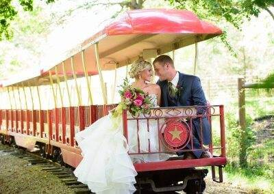 Newlyweds enjoying a train ride at the zoo