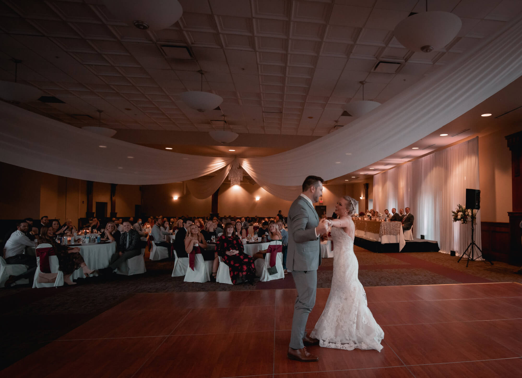 A couple dances their first dance at their wedding in the Forte grand ballroom.